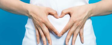 hands in the shape of a heart over gut, gut health and probiotics